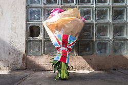 June 4, 2017 - London, England, United Kingdom - Flowers with the message 'Pure Evil Act R.I.P. London Will Never Give In' are left at a police cordon near Borough Market after a terrorist incident in which seven people are reported to have been killed. A white van veered off the road hitting a number of pedestrians before several men attacked people with knives. (Credit Image: © Rob Pinney/London News Pictures via ZUMA Wire)