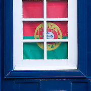Portuguese flag on the door of a house in the Alfama district of Lisbon