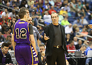Aransas Pass Panthers head coach Glen Hayes talks to Aransas Pass Panthers junior guard Gregory Giageos (12) and Aransas Pass Panthers senior center Matt McElroy (52) during the second half of the Class 3A boys state semifinal game between Aransas Pass and Brownfield at the Alamodome in San Antonio on Thursday, March 10, 2016.