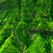 This photo was taken on the western side of the island of Kauai.  This is a view from the inside of Wai'ale'ale Crater.  This is one of the wettest spots on earth.