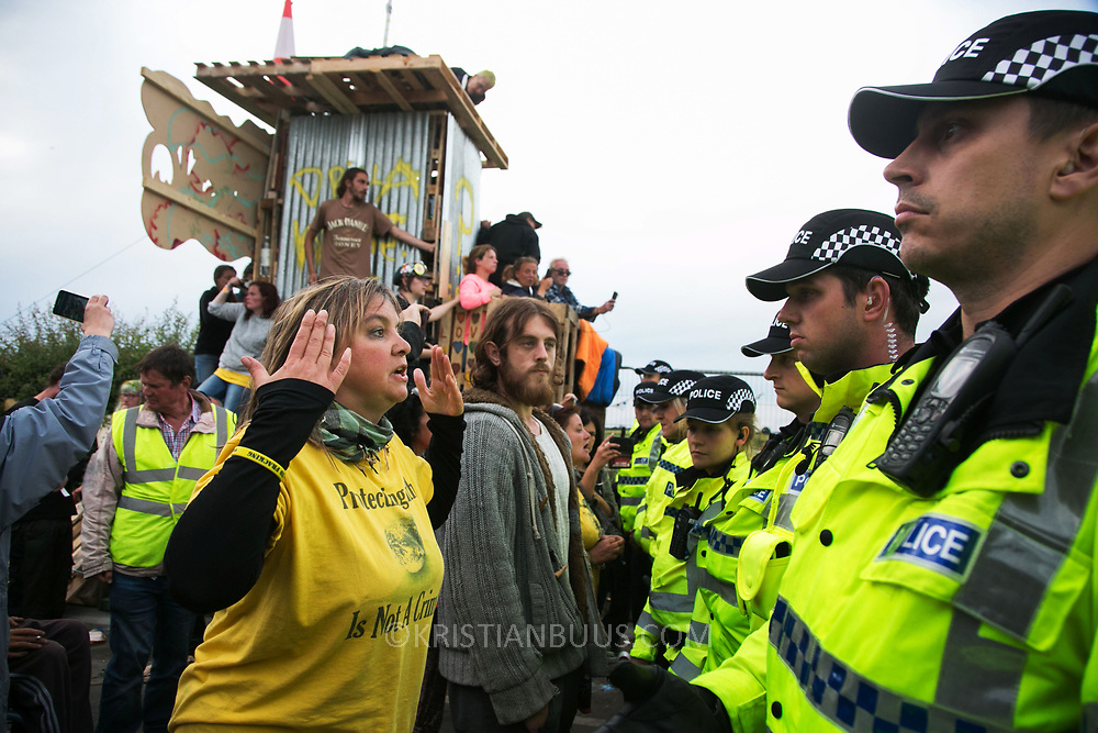 13 local activists locked themselves in specially made arm tubes to block the entrance to Quadrilla's drill site in New Preston Road, July 03 2017, Lancashire, United Kingdom. Councillor Miranda Cox arrived back to the protest after having been released from jail. The 13 activists included 3 councillors; Julie Brickles, Miranda Cox and Gina Dowding and Nick Danby, Martin Porter, Jeanette Porter,  Michelle Martin, Louise Robinson,<br /> Alana McCullough, Nick Sheldrick, Cath Robinson, Barbara Cookson, Dan Huxley-Blyth. The blockade is a repsonse to the emmidiate drilling for shale gas, fracking, by the fracking company Quadrilla. Lancashire voted against permitting fracking but was over ruled by the conservative central Government. All the activists have been active in the struggle against fracking for years but this is their first direct action of peacefull protesting. Fracking is a highly contested way of extracting gas, it is risky to extract and damaging to the environment and is banned in parts of Europe . Lancashire has in the past experienced earth quakes blamed on fracking.