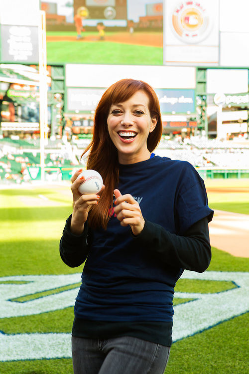 Alie Ward gets ready to throw out the first pitch at a Detroit Tigers game while promoting The Henry Ford's Innovation Nation.  Photographed by PR Photographer Kristina Sikora for The Henry Ford.