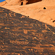 One of several sections of ancient petroglyphs along Mouse's Tank trail in Valley of Fire State Park. Nevada's oldest and largest state park, it derives its name from red sandstone formations, formed from great shifting sand dunes during the age of dinosaurs. These features, which are the centerpiece of the park's attractions, often appear to be on fire when reflecting the sun's rays.