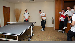 CARDIFF, WALES - Tuesday, September 4, 2012: Wales' Ben Davies and captain Aaron Ramsey celebrates winning a match during a players' table tennis tournament at the St. David's Hotel ahead of the Brazil 2014 FIFA World Cup Qualifying Group A match against Belgium. (Pic by David Rawcliffe/Propaganda)