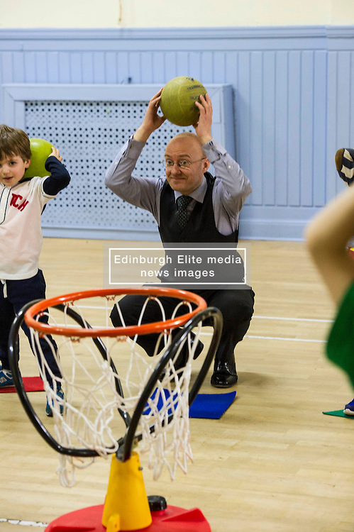 Pictured: Parrick Harvie, Scottish Green party co-convener<br /> <br /> Patrick Harvie, Co-Convenor of the Scottish Green Party met children at the Enjoy-a-Ball Holiday camp taking place at the North Merchiston Community Centre ahead of Tuesday's TV debate. Mr Harvie was joined by fellow MSP candidates Andy Wightman, Local Government Spokesperson, Maggie Chapman, Co-convener and Alison Johnston candiate for Lothian to present taxation proposals and answer questions.<br /> <br /> Ger Harley | EEm 29 March 2016