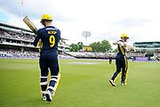 Aneurin Donald and Tom Alsop of Hampshire walk out to open the innings for Hampshire during the Royal London One-Day Cup final  between Somerset County Cricket Club and Hampshire County Cricket Club at Lord's Cricket Ground, St John's Wood, United Kingdom on 25 May 2019.