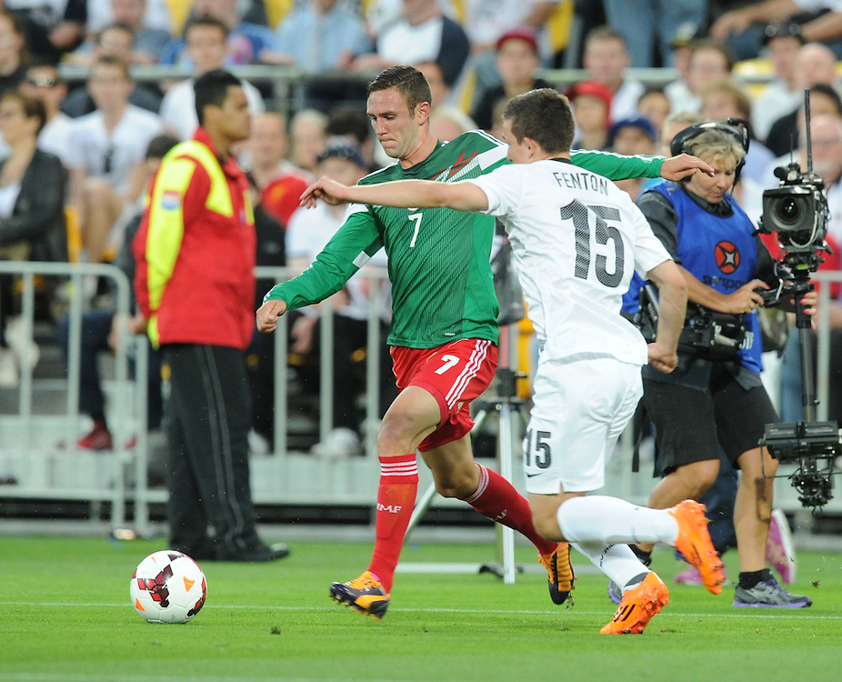 Mexico's Miguel Layun runs around New Zealand's Louis Fenton in the World Cup Football qualifier, Westpac Stadium, Wellington, New Zealand, Wednesday, November 20, 2013. Credit:SNPA / Ross Setford