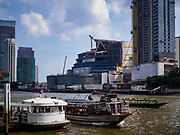 29 JUNE 2018 - BANGKOK, THAILAND: The Chao Phraya River near River City in Bangkok. Across the river is the Icon Siam retail development.      PHOTO BY JACK KURTZ