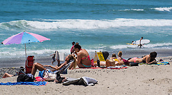 June 14, 2017 - San Clemente, California, USA - Beach goers and surfers enjoy the summer sun near the San Clemente Pier on Wednesday, June 14, 2017. The Heal the Bay's new beach report card lists the San Clemente Pier area in San Clemente, as one of the ten worst in the state for bacteria pollution..(Photo by Mark Rightmire, Orange County Register/SCNG) (Credit Image: © Mark Rightmire, Mark Rightmire/The Orange County Register via ZUMA Wire)