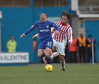Photo. Leigh Quinnell.  Millwall v Stoke City Coca Cola championship. 19/02/2005. Stokes Darel Russell tackles Millwalls Alan Dunne.