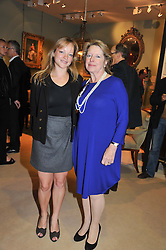 Left to right, the HON.LEONORA GUMMER and her mother LADY DEBEN at a preview evening of the annual London LAPADA (The Association of Art & Antiques Dealers) antiques Fair held in Berkeley Square, London on 18th September 2012.
