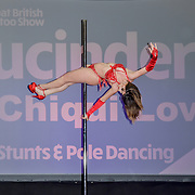 Lucinda (Multi Hoop) & Tilite (pole) performs at The Great British Tattoo Show, at Alexandra Palace, on 26 May 2019, London, UK.