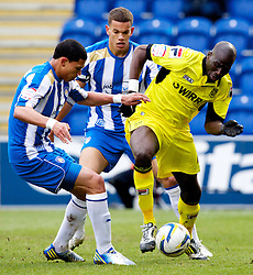 COLCHESTER, ENGLAND - Saturday, February 23, 2013: Tranmere Rovers' Mamady Sidibe in action against Colchester United's Bradley Garmston and captain Josh Thompson during the Football League One match at the Colchester Community Stadium. (Pic by Vegard Grott/Propaganda)