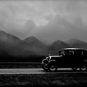 On the road to Hanmer Springs...A leisurely Sunday drive for a vintage car....You would be forgiven for thinking you'd just stepped out of a time machine while travelling around the South Island of New Zealand.. From the misty shades of grey in the fiord of Doubtful Sound, to the fully operational Steamboat the TSS Earnslaw; the Lady of the Lake on Lake Wakitepo, this beautiful island is a Tardis for tourists!..The South Island of New Zealand is roughly the size of England, but it's population of less than a million people means much of the land remains free from human development. It's breathtaking views, and it's climate, could be likened to a cross between Scotland and Scandinavia, and around every corner is mostly unspoilt natural beauty....The Commercialised resort town of Queenstown is the nerve centre of the islands tourism industry, providing the more adventurous thrill seeker with jet boating, skydiving, bungy jumping, and paragliding to name just a few of the more adventurous activities..Queenstown also provides numerous Lord of the Rings tours into middle earth.. In stark contrast the TSS Earnslaw, The Vintage Steamship which has graced the waters of Lake Wakatipu since 1912 provides daily voyages to Walters Peak and a step back in time for it's passengers. The voyage even includes a good old fashion sing-a-long to songs of yesteryear...Just forty five minutes out of Queenstown the Kingston Flyer, a vintage steam train still operates on 14km of track using two AB Pacific Class steam locomotives built in 1925 and 1927 respectively, although the Flyer's history began much earlier in 1878 when it operated between the main south line and Gore..Fiordland on the southWestern side of the Island has some of the world's greatest treks; indeed the Milford Track is often booked up way in advance...