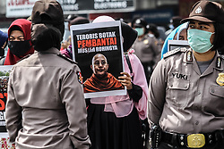 September 6, 2017 - Medan, North Sumatra, Indonesia - Riot police guarded as Indonesian Muslim women holding Myanmar nationalist Buddhist monk Wirathu posters during a demonstration rally over the Rohingya minority persecution in Medan. Indonesian Muslims held angry demonstrations against the persecution and condemned the worsening humanitarian situation in Rakhine state, also called on the Indonesian government to take a tougher stance against it for an end to violence against the Rohingya Muslim minority in the country. (Credit Image: © Ivan Damanik via ZUMA Wire)