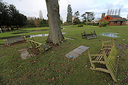 © Licensed to London News Pictures. 25/12/2013. The day after the River Mole flooded Leatherhead crematorium, benches were left scattered and strewn across this area as mourners vpayed their respects to loved ones on Christmas Day.  Credit : Rob Powell/LNP