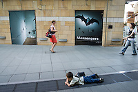 """A boy plays in Roppongi Hills in front of Annette Messager's Tokyo show, """"The messengers"""", Tokyo, Japan."""