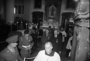 The remains of Roger Casement, Irish Patriot, were removed from the Military Church, Arbour Hill, where they lay in state for 4 days, to the Pro-Cathedral..Picture shows President de Valera, accompanied by his Aide-de-Camp, Col. Seán Brennan, leaving the coffin of Roger Casement in the Pro-Cathedral..18.02.1965