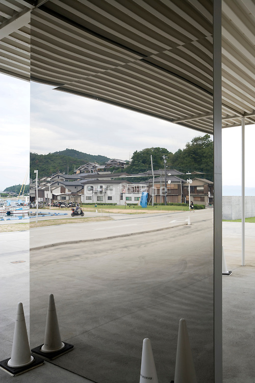 Japanese village Honmura on Naoshima Island reflected in mirrored pillar