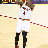 10 June 2016: Cleveland Cavaliers guard Iman Shumpert (4) takes a jump shot during the Golden State Warriors 108-97 victory over the Cleveland Cavaliers, during Game Four of the 2016 NBA Finals at the Quicken Loans Arena, Cleveland, Ohio, USA.