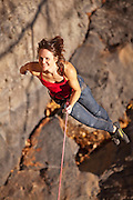 "Elaina Arenz being lowered off ""Mister Fantasy"" 11c at the ""Endless Wall,"" New River Gorge, West Virginia."