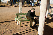 14 FEBRUARY 2003 - PUERTO PENASCO, SONORA, MEXICO: An elderly man sits by himself on a bench near the town of Puerto Penasco, state of Sonora, Mexico. Puerto Penasco is known as Rocky Point among US tourists. It is in the state of Sonora, on the Sea of Cortez.  PHOTO BY JACK KURTZ