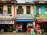 13 DECEMBER 2018 - SINGAPORE:  Traditional shophouses in the Geylang neighborhood. The Geylang area of Singapore, between the Central Business District and Changi Airport, was originally coconut plantations and Malay villages. During Singapore's boom the coconut plantations and other farms were pushed out and now the area is a working class community of Malay, Indian and Chinese people. In the 2000s, developers started gentrifying Geylang and new housing estate developments were built.     PHOTO BY JACK KURTZ