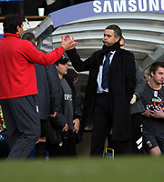 """A Relieved Jose Mourinho Manager Chelsea after final whistle as he shakes hands with Fulham""""s Manager Chris Coleman<br />Chelsea V Fulham (3-2) Premier League Stamford Bridge London<br />London England 26/12/05<br />Photo Robin Parker Fotosports International"""