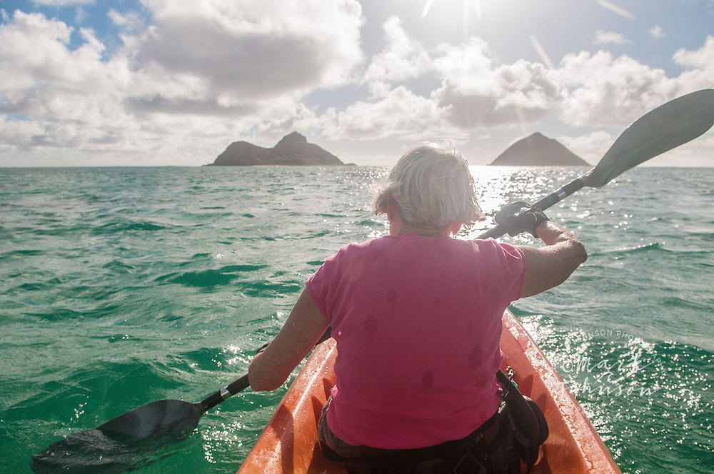 Mature woman kayaking near the Mokulua Islands, Kailua Bay, Oahu, Hawaii