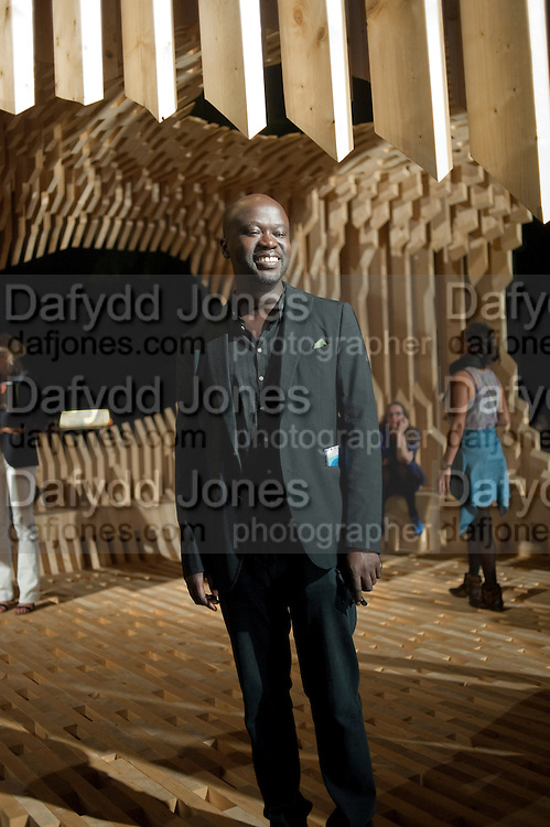DESIGN MIAMI'S DESIGNER OF THE YEAR ARCHITECT DAVID ADJAYE WITH HIS PAVILION 'GENESIS'. , Opening of the Design Fair. Miami Art Basel 2011, Miami Beach. 29 November 2011.
