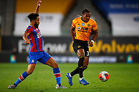 2019 / 2020 Premier League - Wolverhampton Wanderers vs Crystal Palace <br /> <br /> Andros Townsend of Crystal Palace and Adama Traore of Wolverhampton Wanderers  at Molyneux.<br /> <br /> Credit COLORSPORT/LYNNE CAMERON
