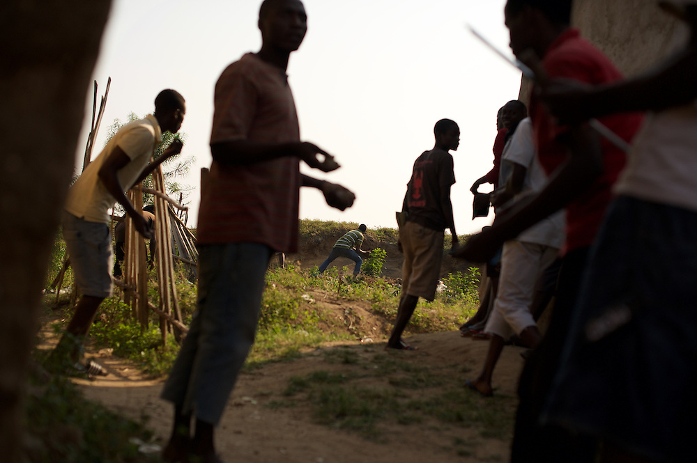 Demonstrators in Musaga, a district in Burundi's capital Bujumbura that has been at the heart of violent protests against the presidents third term bid, throw stones during sustained automatic fire allegedly fired by police forces.