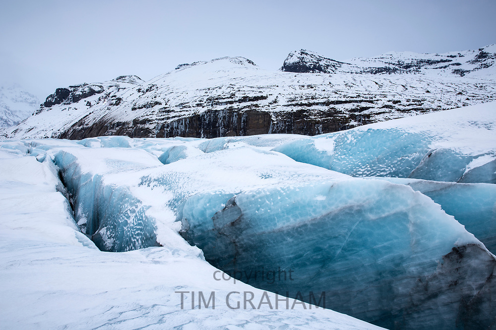 Close up showing layers in ice blocks and crevasse in glacial tongue of Svinafellsjokull an outlet glacier of Vatnajokull, South Iceland