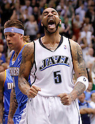 Utah Jazz forward Carlos Boozer (5) celebrates after scoring and getting fouled as Denver Nuggets center Chris Anderson ,left, walks past during the second half of Game 6 of the NBA Western Conference first-round playoff series in Salt Lake City, Friday, April 30, 2010. The Jazz defeated the Nuggets 112-104, to advance to the second round. (AP Photo/Colin E Braley)