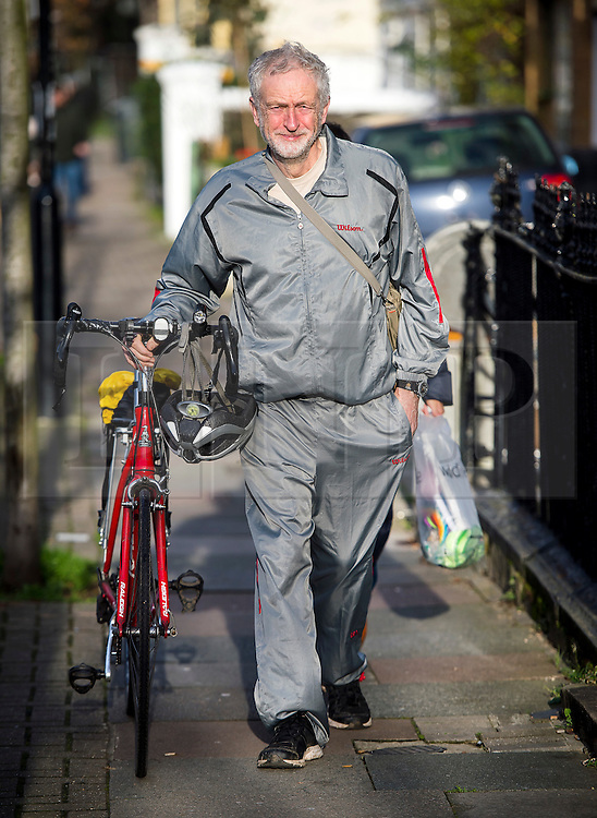 **FILE PICTURE - Monday December 21 marks 100 days since Jeremy Corbyn became leader of the Labour Party**© Licensed to London News Pictures. 28/11/2015. London, UK. Labour Party leader JEREMY CORBYN  pushing his bike while leaving home in Islington, north London this morning (Sat). Jeremy Corbyn has come under pressure from his own party over a potential vote on UK military involvement in Syria. Photo credit: Ben Cawthra/LNP