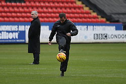 Referee Keith Stroud checks the pitch before giving the go ahead for the rain delayed match - Photo mandatory by-line: Robin White/JMP - Tel: Mobile: 07966 386802 09/11/2013 - SPORT - FOOTBALL - The Valley - Charlton - Charlton Athletic v Leeds United - Sky Bet Championship