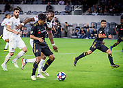 Los Angeles FC forward Carlos Vela (10) makes the move for the goal against FC Cincinnati defender Kendall Waston (2) during a MLS soccer match in Los Angeles, Saturday, April 13, 2019. LAFC defeated FC Cincinnati 2-0. (Ed Ruvalcaba/Image of Sport)