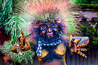 """Cupak the Glutton: The demon Cupak is a Ogoh Ogoh, a very powerful glutton, with prominent colourful hair that stands on end and he awaits the ceremonial parade down the streets of Balian Beach, during the traditional celebration of Nyepi, the """"Day of Silence"""", Bali Indonesia."""