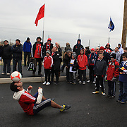 Spectators are entertained with ball skills outside the Red Bull Stadium before the New York Red Bulls V Montreal Impact game at Red Bulls Stadium, New Jersey. USA. 31st March 2012. Photo Tim Clayton