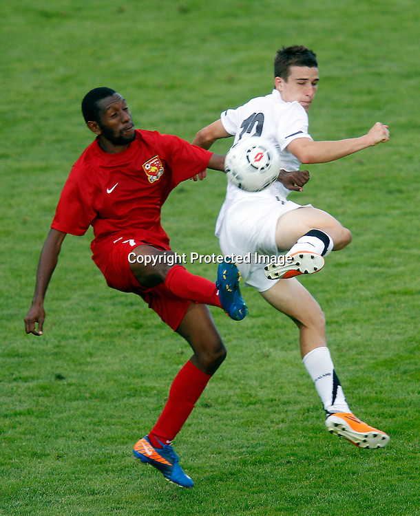 NZ's Louis Fenton goes up against PNG's Eliud Fugre. OFC Men's Olympic Qualifier New Zealand 2012, New Zealand v Papua New Guinea, Owen Delany Park Taupo, Friday 16th March 2012. Photo: Shane Wenzlick