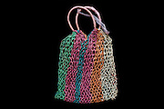 Many hands (including May May Than and Yu Nwe, also detained under Section 5-J) in the women's section of Insein Prison were involved in making woven plastic bags like this one.