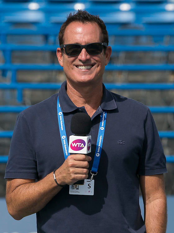 August 23, 2014, New Haven, CT:<br /> Host Andrew Krasny poses for a photograph on day nine of the 2014 Connecticut Open at the Yale University Tennis Center in New Haven, Connecticut Saturday, August 23, 2014.<br /> (Photo by Billie Weiss/Connecticut Open)