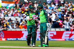 Faf du Plessis of South Africa and Rassie van der Dussen of South Africa high five in the middle - Mandatory by-line: Robbie Stephenson/JMP - 06/07/2019 - CRICKET - Old Trafford - Manchester, England - Australia v South Africa - ICC Cricket World Cup 2019 - Group Stage