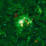 In the Perseus spiral arm of the Milky Way galaxy, opposite the galactic center, lies the nebula SH 2-235, a huge star formation complex. WISE.
