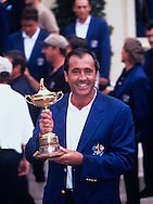 Seve Ballesteros holds the trophy as winning captain<br /> PHOTO MARK NEWCOMBE / 32nd RYDER CUP 1997