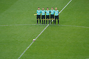 Referees observe a minute of silence for the victims of the Manchester terror attack before the French Cup final football during the 100th French Cup, Final football match between SCO Angers and Paris Saint-Germain on May 27, 2017 at Stade de France in Saint-Denis, France - Photo Stephane Allaman / ProSportsImages / DPPI