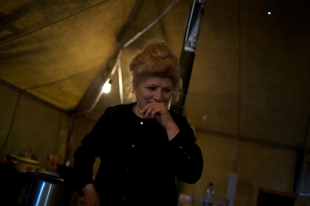 KHERSON, UKRAINE - March 18, 2014: A babushka at a self-defence group's tent near the Crimean border, in the Kherson region of Ukraine. CREDIT: Paulo Nunes dos Santos