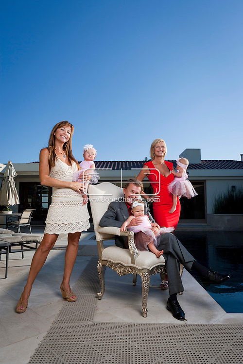 25th August 2011. Dana Point, California. DeAun Nixon, who has given birth to a set of triplets for herself and a set of surrogate triplets for her friends Larry & Kristina Dodge. Pictured are Larry (suit), Kristina  (tan dress), DeAun (red dress), Austin (eldest, purple shirt / black T)  11-year-old triplets - Nicholas (purple shirt), Thomas (striped polo) and Alexa Bhardwaj (purple dress).  6 month old triplets, Tatiani , Alexandra and Cozette Dodge, and Laurenz Dodge (blue top and jeans).Photo © John Chapple / www.chapple.biz