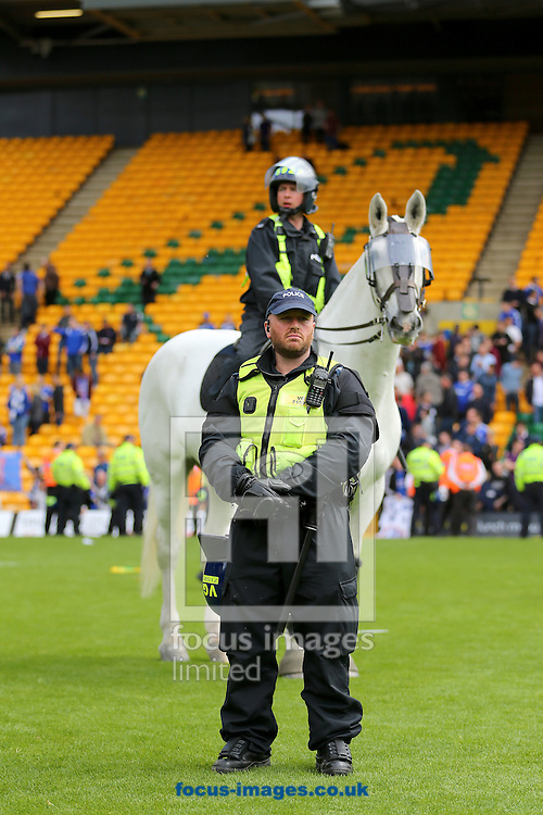 Police formed a line on the pitch to prevent Ipswich Town and Norwich City fans clashing following the Sky Bet Championship match at Carrow Road, Norwich<br /> Picture by Richard Calver/Focus Images Ltd +44 7792 981244<br /> 16/05/2015