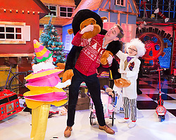 **Embargoed untill 6am Friday 28th November**  Repro Free: 27/11/2014 Ryan Tubridy is pictured revealing the set for this years The Late Late Toy Show - and it promises to be Truly Scrumptious! The theme of this year's show is based on the iconic musical film Chitty Chitty Bang Bang with the opening act to include a performance of a much-loved song from the film with Ryan taking part in the performance. Ryan is pictured with just 2 of the 269 performers and toy testers in this years show Julia Dempsey (8) from Carlow and Cara Hayes (9) from Dublin. Picture Andres Poveda